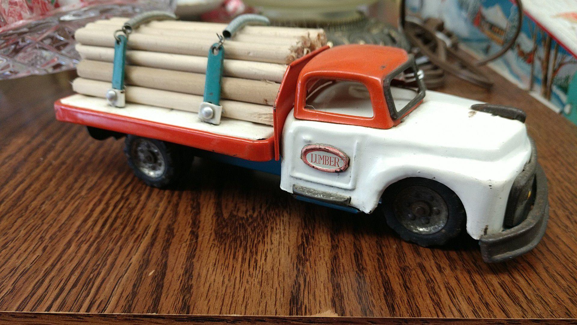 Vintage 1950s lumber truck toy