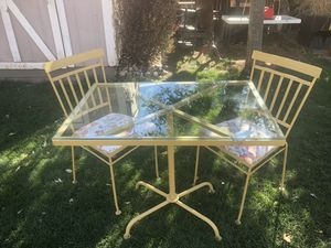 Vintage glass top wrought iron table and 2 chairs for Sale in Denver, CO