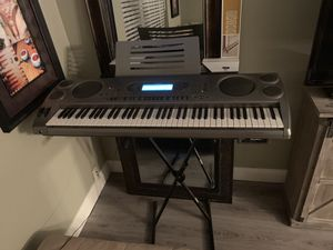 Casio WK-1800 Keyboard Piano, Music Disk, and Piano Stand for Sale in Fort Lauderdale, FL
