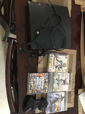 Photo PS3 plus controller and 4 games