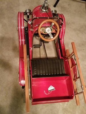 Children riding fire truck well built antique peddle car, be the dad or grandpa of the year for Sale in Temple Hills, MD