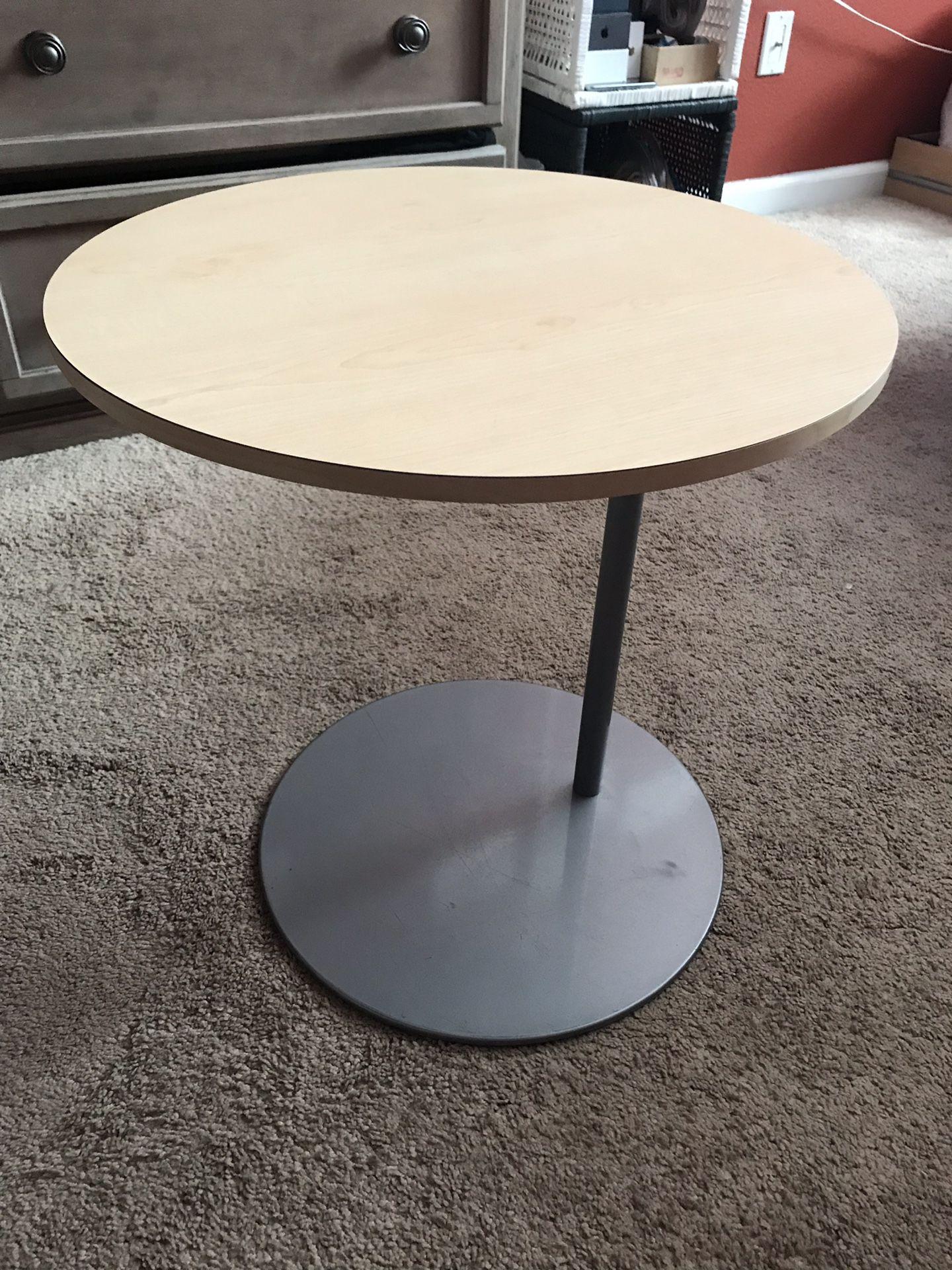 Round white wooden pedestal table