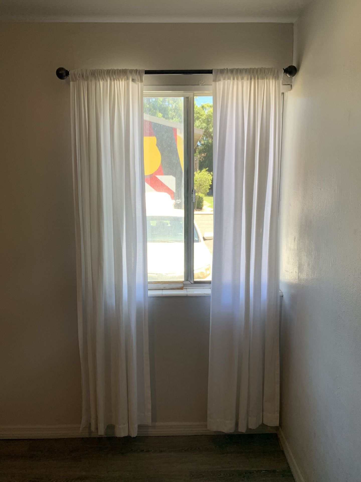 White curtain panels and bronze rod!