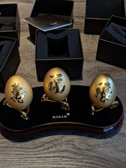 Chinese RISIS Golden Wealth Collection real eggshells encapsulated in 24K Swiss Gold. $688 retail. Includes set of 3 gold eggs. Brand New condition.  Thumbnail