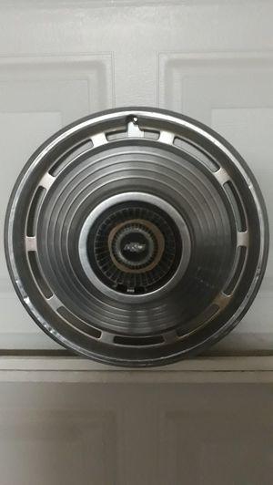 Photo 2 old chevy hub caps..