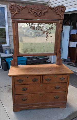 Photo Antique Dresser with Ornate Mirror