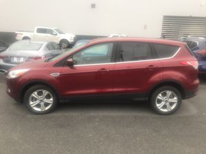 2016 Ford Escape SE FWD in Ruby Red with only 32,183 miles for $13,998. for Sale in Fairfax, VA