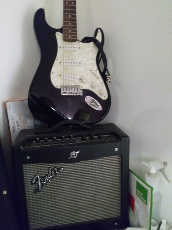 Fender Stratocaster electric giutar & peavey amp with chord. for ...