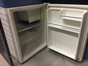 GE mini fridge with small freezer for Sale in St. Louis, MO