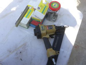 Finish nail gun with 1,000's of nails for Sale in Riverside, CA