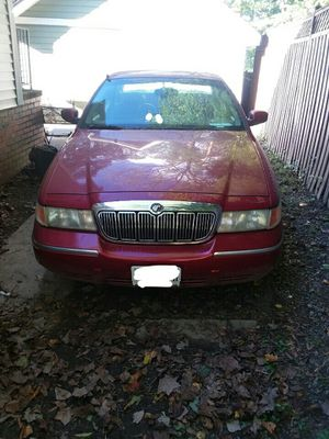 2002 Mercy Grand Marquis maroon color with brown interior for Sale in Arlington, VA