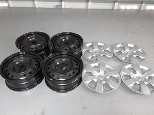 Photo Sale Set of 4 Toyota Camry 2007 16 inch steel rim + 4 Silver original hubcaps almost new, little use