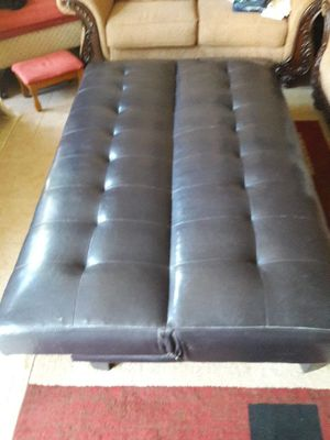 Leather brown futon ottoman very good condition brown leather for Sale in Elkton, FL