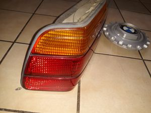 1994 BMW left Tail light with out bulb and wheel BMW logo. for Sale in Baltimore, MD