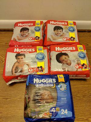 Huggies snug & dry/ OverNites for Sale in Rockville, MD