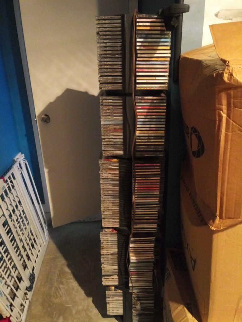400 ORIGINAL DIFFERENT GENRES CDS AND RACKS.