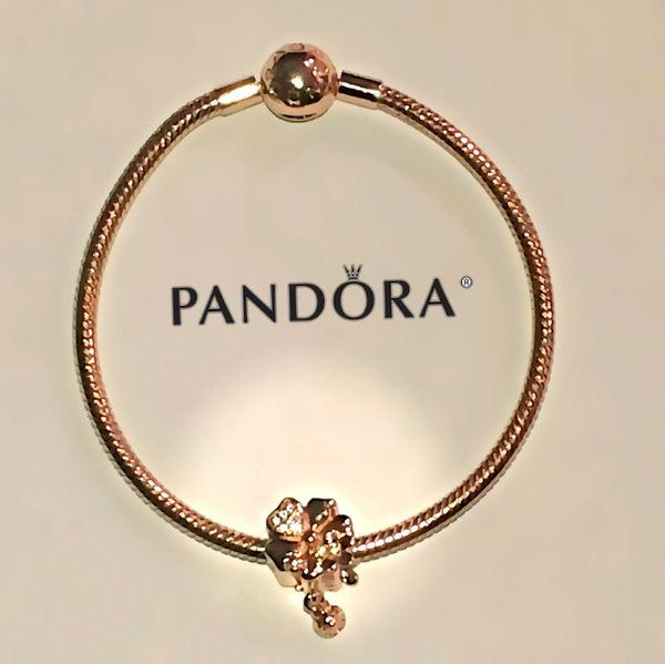d044173f4 Pandora rose gold bracelet + pandora rose gold charm set for Sale in ...
