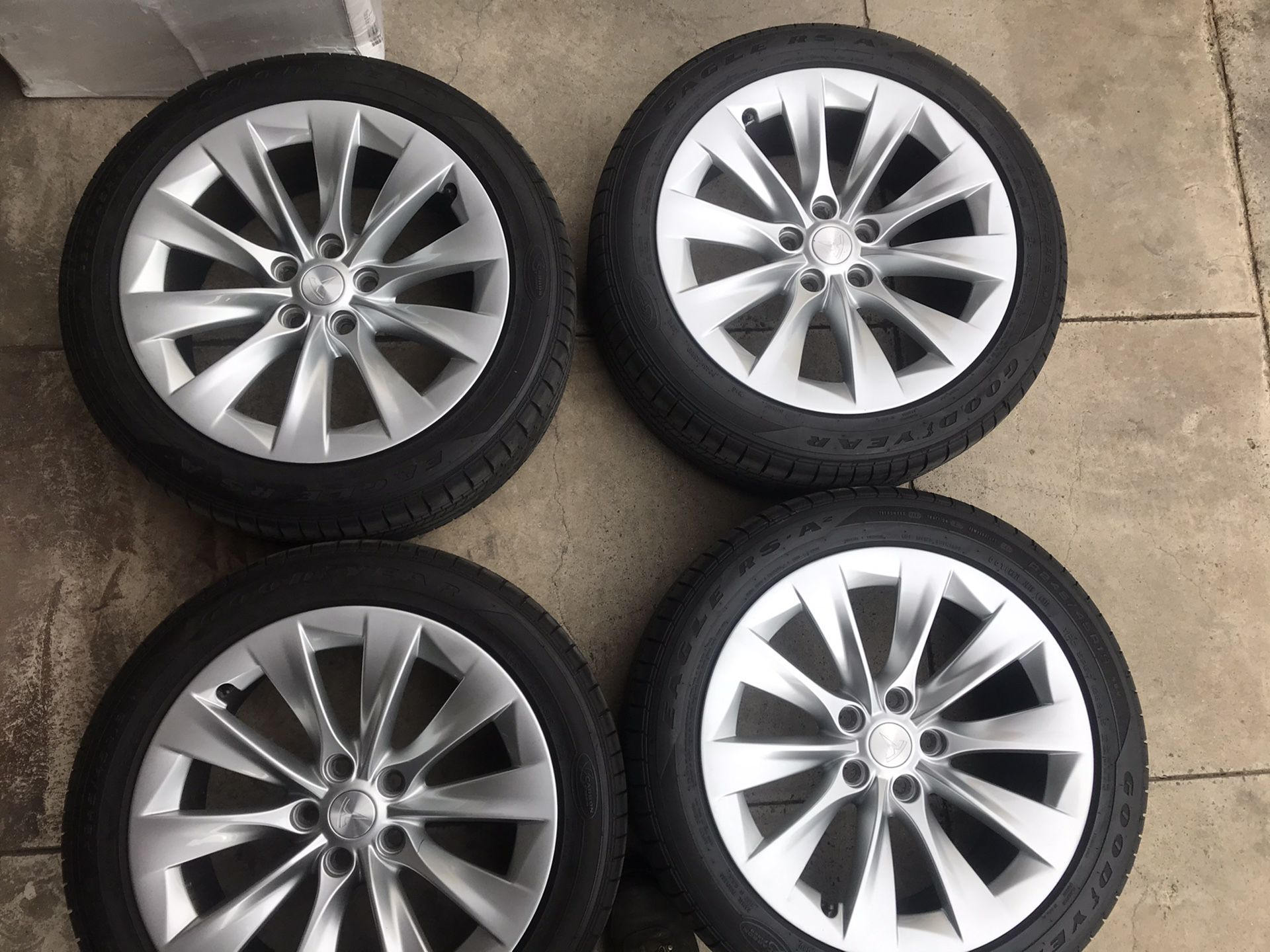 """19"""" Tesla takeoff wheels and Goodyear tires. Super easy financing available"""