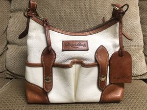 Photo Dooney and Bourke purse. Vacchette leather