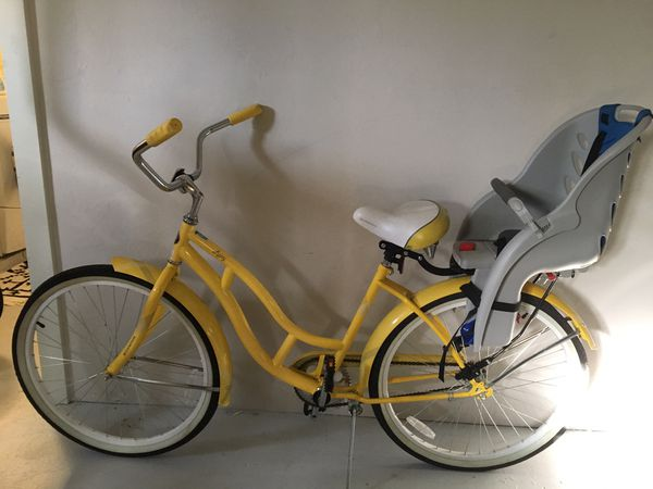 8827a9794db Bright yellow beach cruiser Schwinn bike with removable infant seat ...