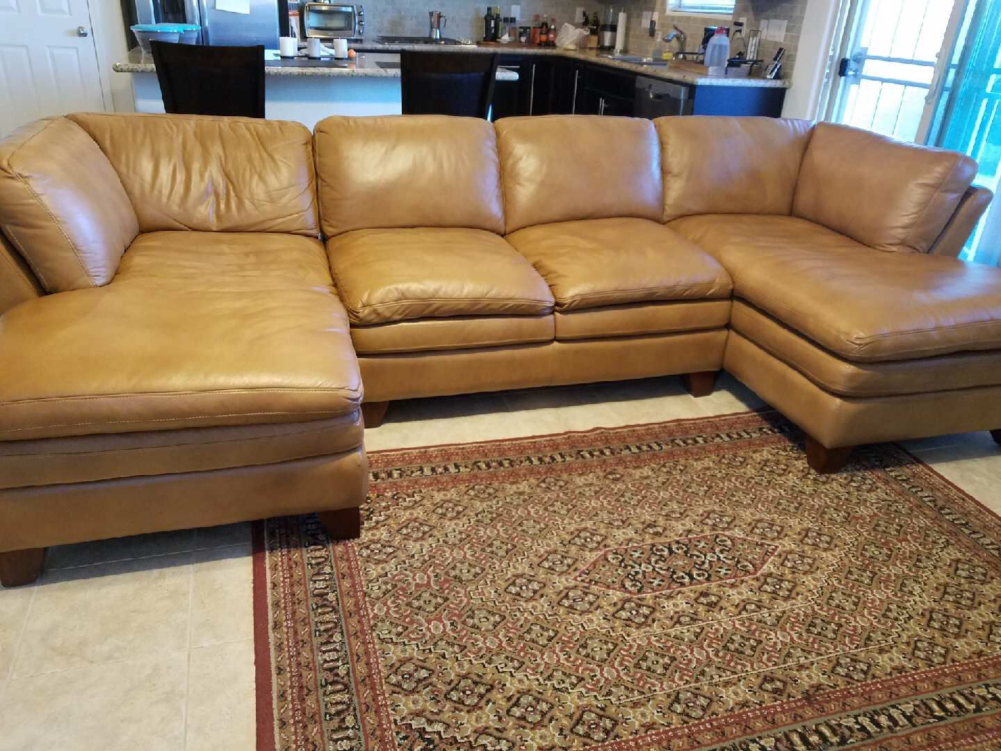 Great 100% leather couch, your house needs it