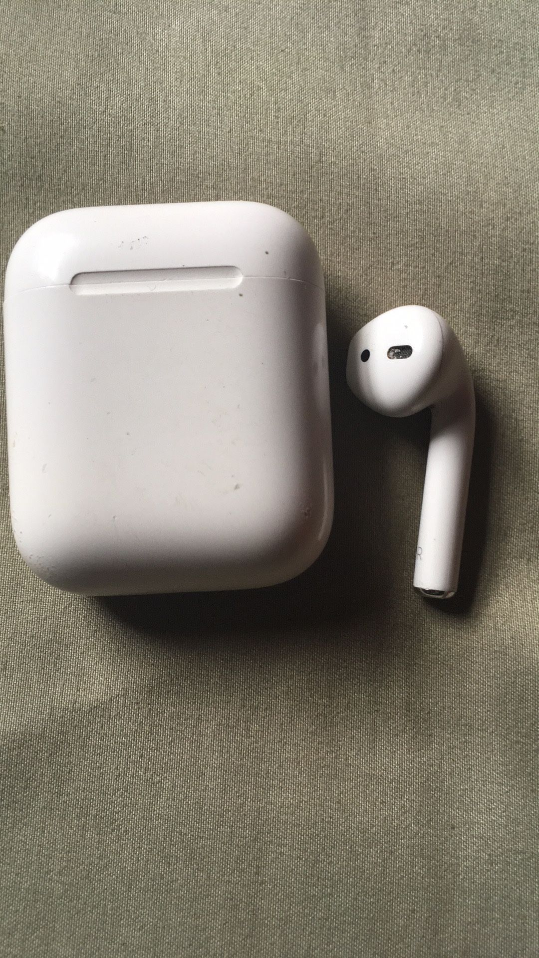 Right Apple air pod and charging box