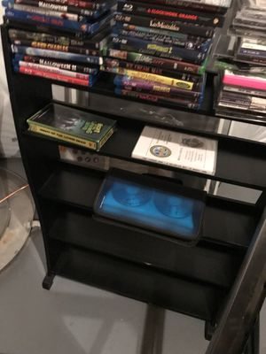 Black dvd stand (no movies included) for Sale in Gainesville, VA