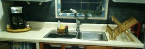 Photo Kitchen counter top with stainless steel sink & Moen faucet