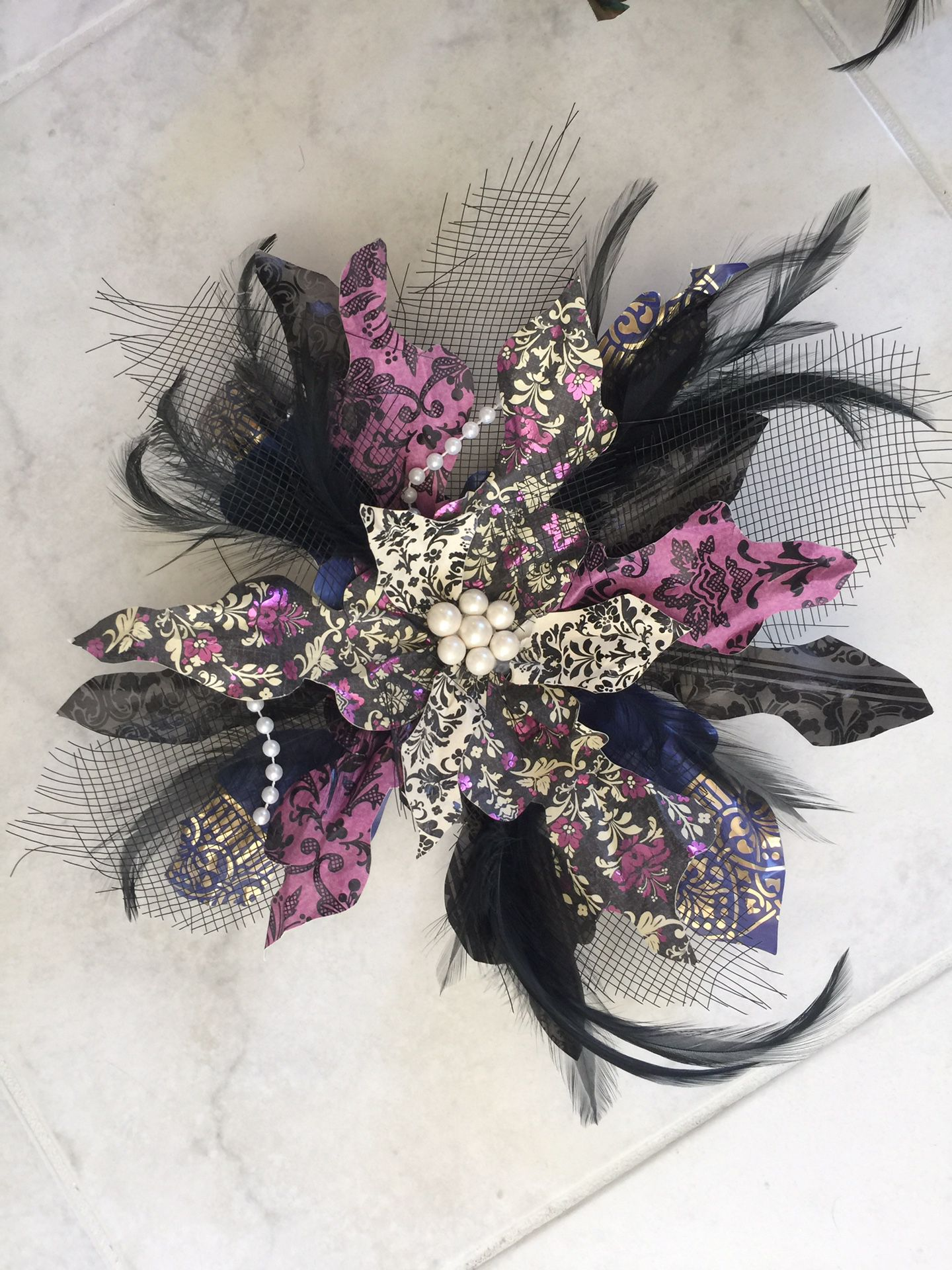 Decorations. Party. Feather. Pearl. Paper pinwheels