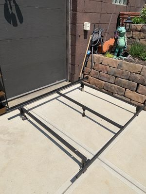 Photo Pick up today FULL size (Not queen size) bed frame on wheels excellent condition