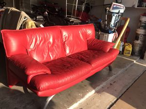 Photo Candy apple red leather couch