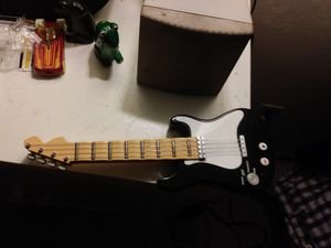 Mini electric guitar battery operated plays recordes and plays back your recordings for Sale in Sanford, FL