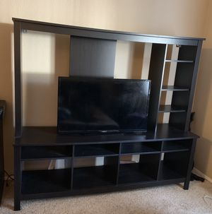 $150 IKEA TV stand (TV not included) it's about 51/2 feet height and 6 feet wide. Our 65 inch tv fit almost perfect. for Sale in Renton, WA