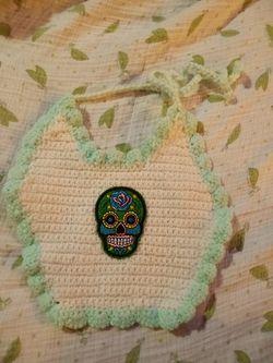 Hand-knitted sugar skull baby bib Thumbnail