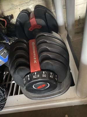 Photo Bowflex dumbells used with stand