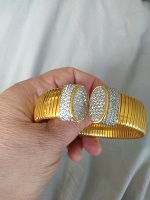 BEST OFFER-Gold over silver flexible bracelet with crystal end caps for Sale in Grand Island, FL