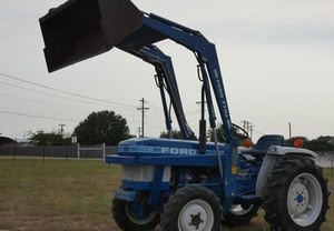1710 Ford with-Bucket 770a for Sale in Denton, TX
