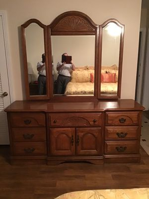 Photo Oak dresser; oak Dinning table and chairs; recliner; chair; baker's rack.