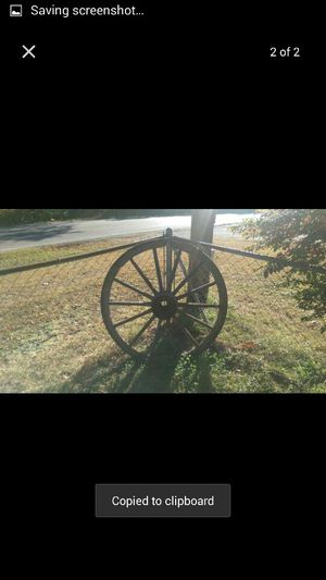 Antique wagon wheels used as yard deco for Sale in St. Louis, MO