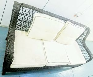 Nice in great condition Wicker all weather indoor or outdoor sofa with washable seat covers for Sale in Long Beach, CA