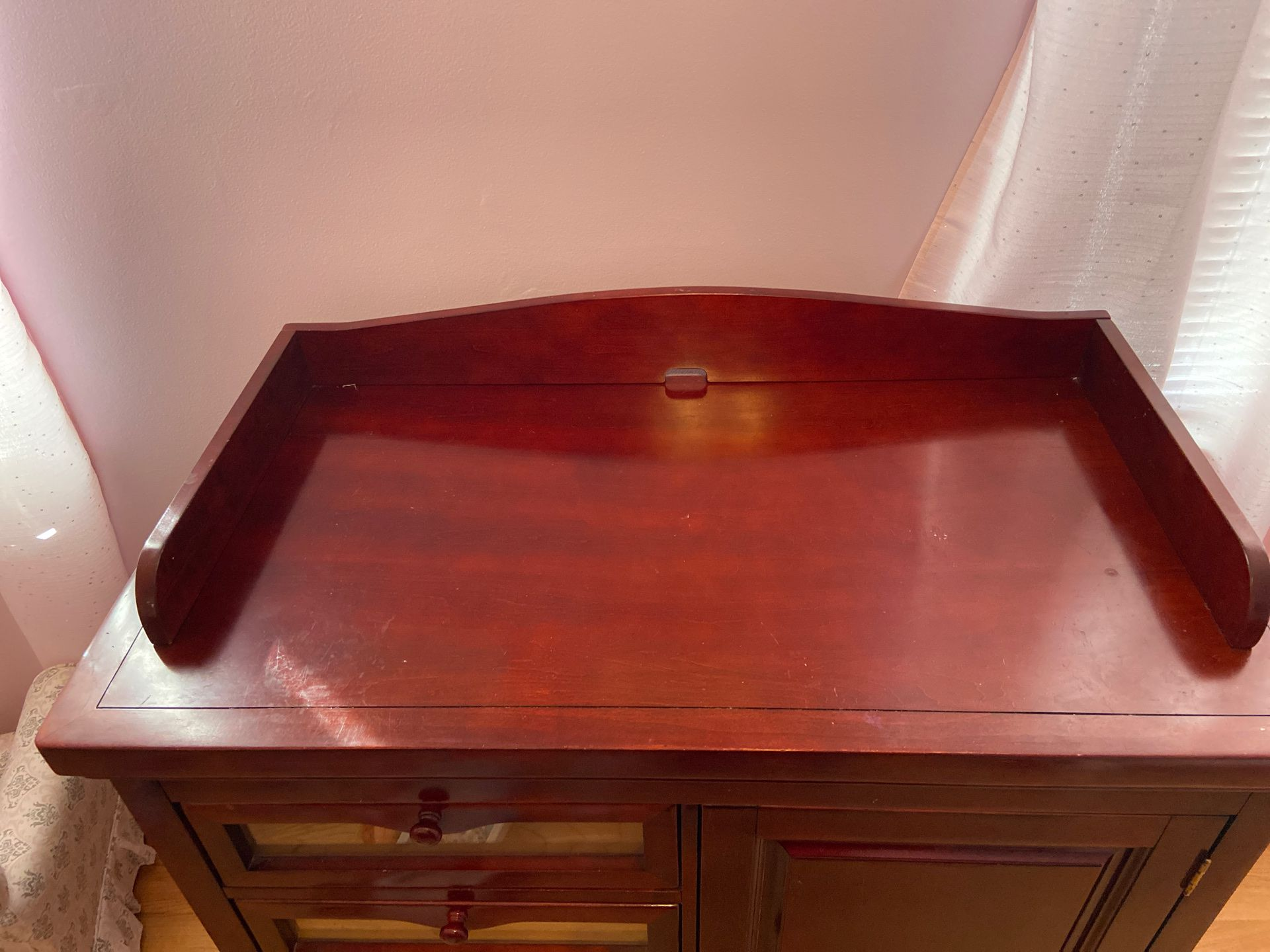 Cherrywood dresser with cabinet and changing top