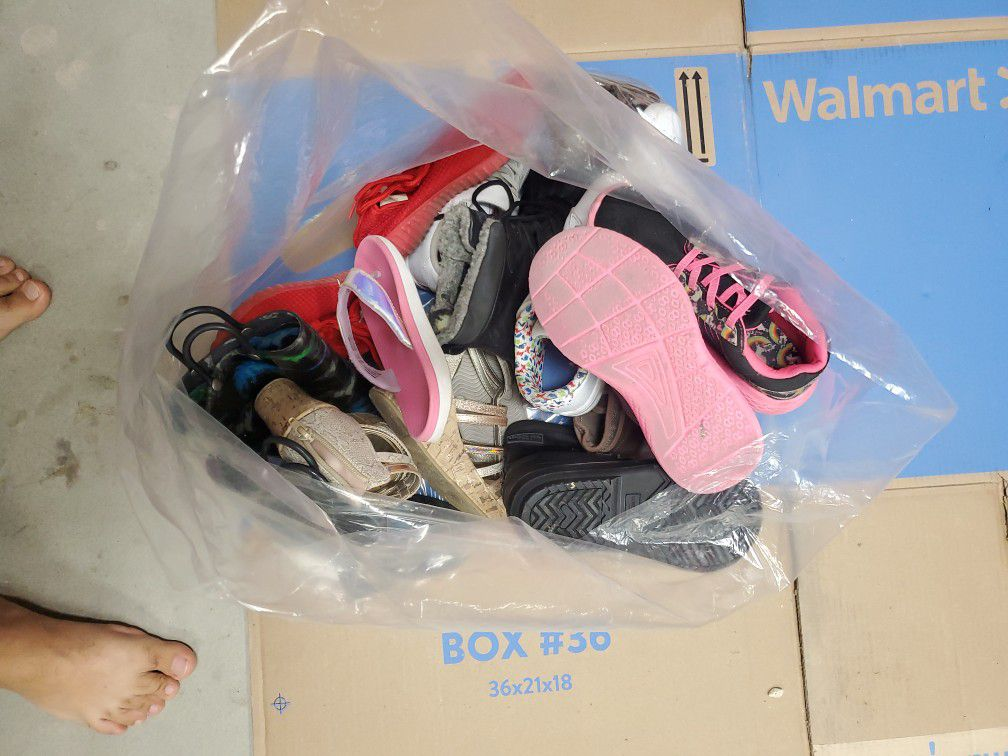 Bag Of Used Girl And Boy Shoes