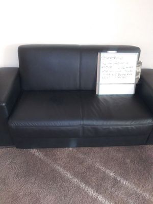 Black leather storage and futon couch. With detachable side for Sale in Washington, DC