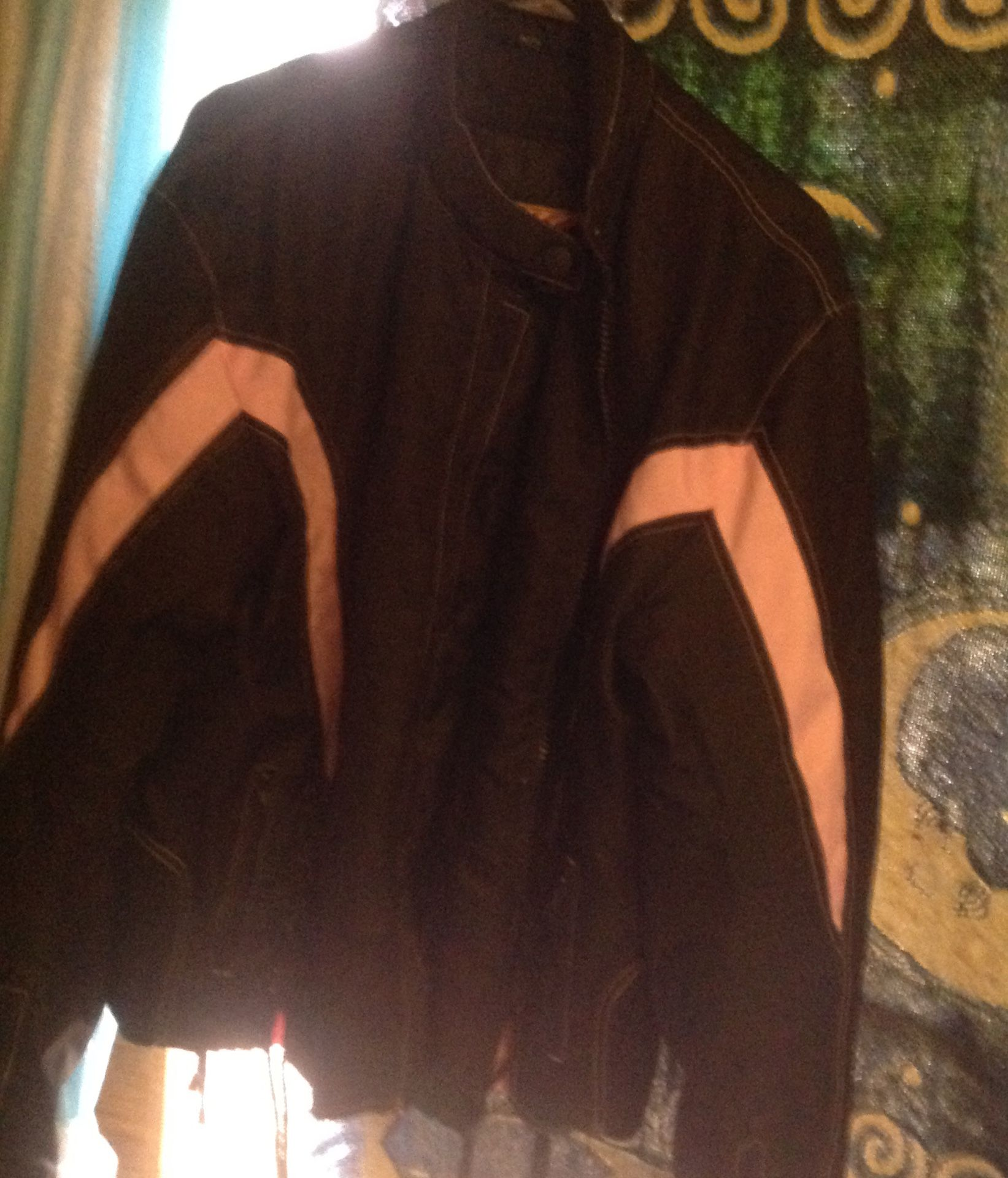 Pink and black riding jacket wore 3 times only want 50 dollars paid 130 for it
