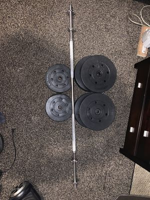 Bench bar with weights for Sale in Elkridge, MD