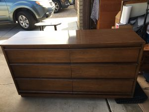 Photo Mid century Vintage 6 drawer dresser. Good vintage condition. No missing wood or veneer. Drawers work as intended. Has a melamine as was common when