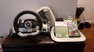 Photo X box 360 steering wheel and gas peddle with 2 racing games.
