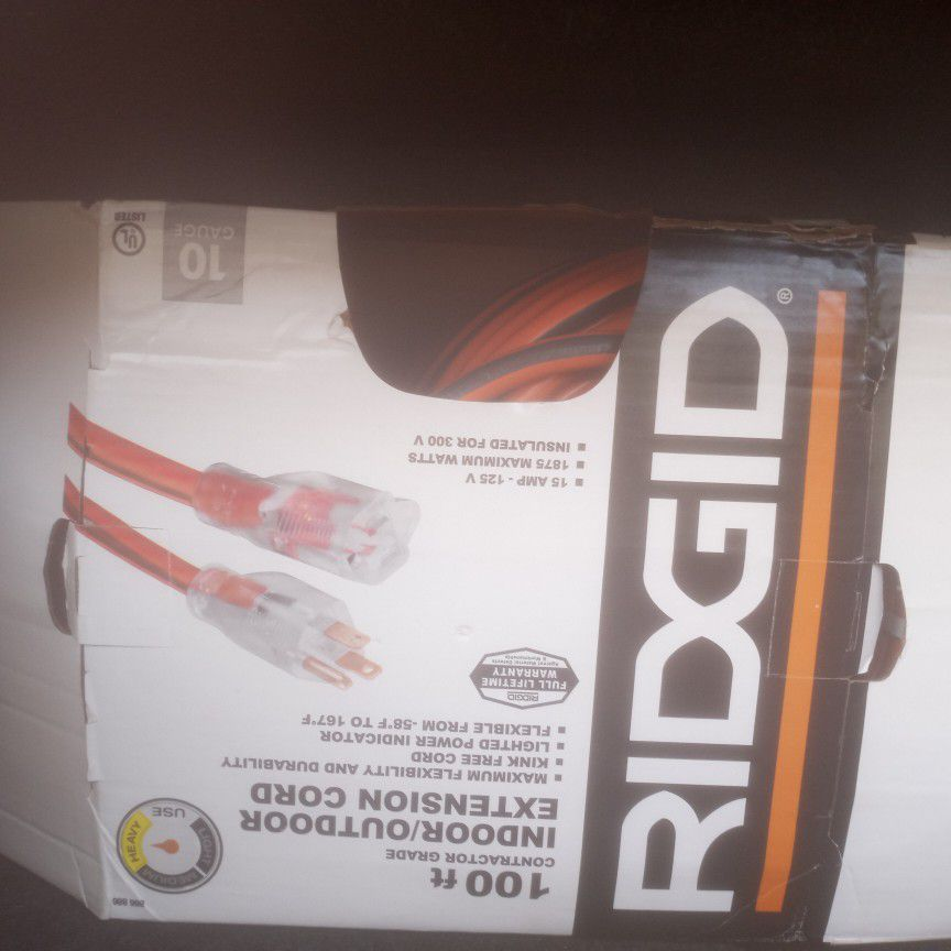 Never used indoor/outdoor Extension cord 100ft