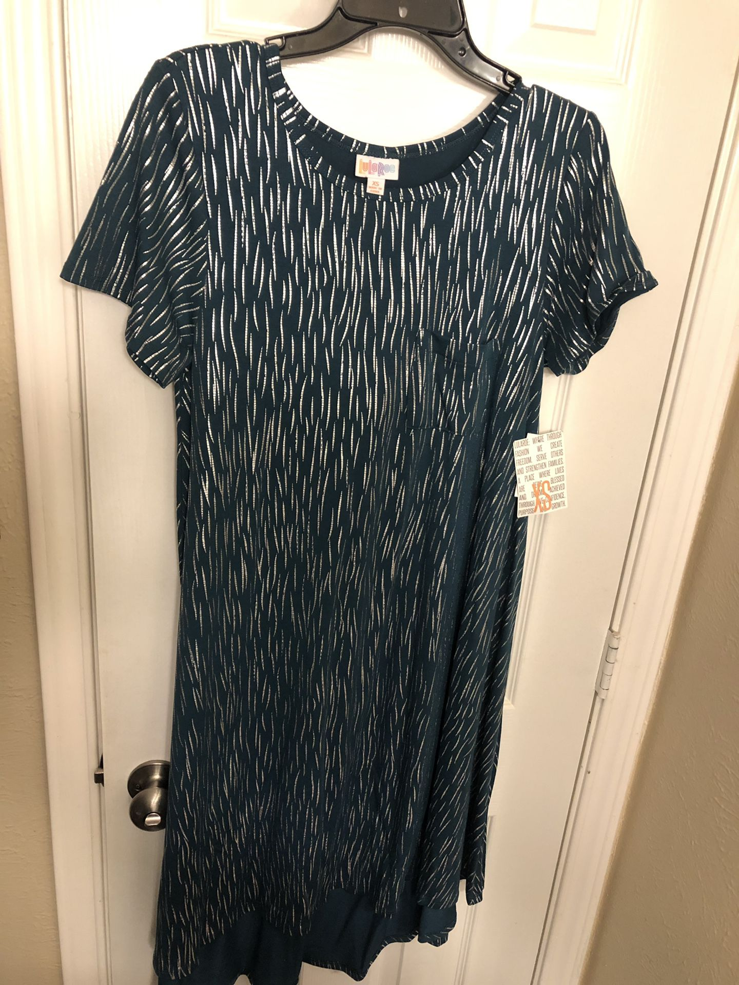 Lularoe extra small Carly (elegant collection, silver shimmer and dark green/teal-like background)