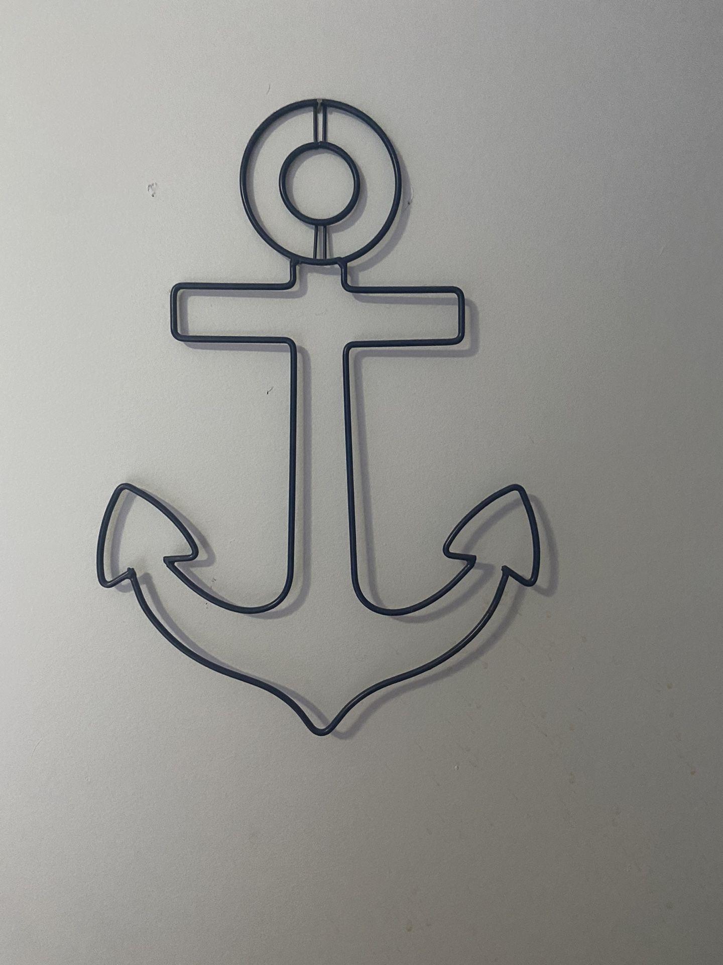 Wall hanging anchor
